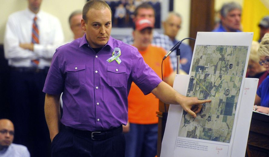 In this photo taken on Tuesday, Oct. 14, 2014, farmer Kyle Broshears talks about his application for a special exception for a 4,000-head swine operation during a Jackson County Board of Zoning Appeals meeting in Jackson Circuit Court in Brownstown, Ind. The board approved the request, which also requires state approval, after more than six hours of comments from those in favor of it and those opposed to it. (AP Photo/The Tribune, Aaron Piper)