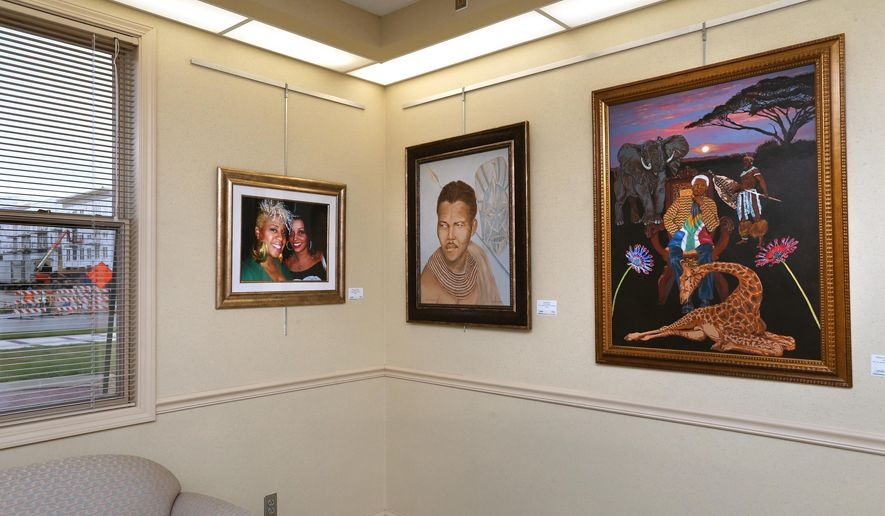 """ADVANCE FOR THE WEEKEND OF OCT. 18-19 AND THEREAFTER - In a July 23, 2014 photo, a multi-cultural art exhibit, """"Flava Fresh,"""" is on display at the Fishers Town Hall. An urban gothic oil painting of a voluptuous woman staring off into the distance by local artist Stephen Osborne was taken down by the Fishers Arts Council after a close look revealed that her left breast was exposed. At times like these, arts council members have to choose between freedom of expression and the moral guidelines set forth by the venue's owner, the Town of Fishers. (AP Photo/The Indianapolis Star, Charlie Nye)  NO SALES"""