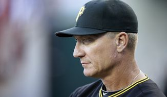 Pittsburgh Pirates bench coach Jeff Banister is seen in the dugout during the second inning of an interleague baseball game against the Detroit Tigers, Wednesday, Aug. 13, 2014 in Detroit. (AP Photo/Carlos Osorio)