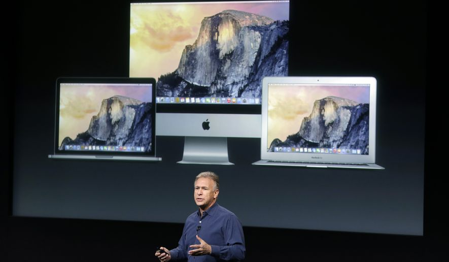 Phil Schiller, Apple's senior vice president of worldwide product marketing, discusses the new desktop and Macbook Air products during an event at Apple headquarters on Thursday, Oct. 16, 2014 in Cupertino, Calif. (AP Photo/Marcio Jose Sanchez)