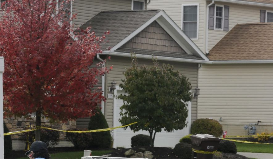 A Tallmadge auxiliary police officer keeps watch on a home Thursday, Oct. 16, 2014 in Tallmadge, Ohio where Amber Joy Vinson stayed over the weekend before flying home to Dallas. At least seven people in northeast Ohio are under voluntary quarantine and being monitored because they had contact with Vinson, a Texas nurse who was diagnosed with Ebola shortly after visiting the area last weekend, health officials said Thursday. (AP Photo/Tony Dejak)