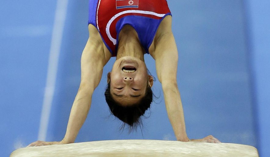 10ThingstoSeeSports - North Korea's Hong Un Jong performs during the women's vault final of the Artistic Gymnastics World Championship at the Guangxi Gymnasium in Nanning, capital of southwest China's Guangxi Zhuang Autonomous Region, Saturday, Oct. 11, 2014. (AP Photo/Andy Wong, File)
