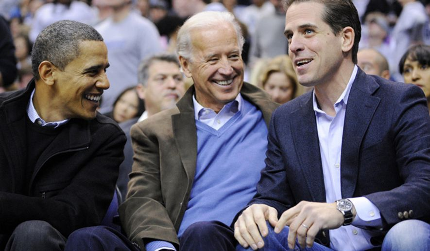Hunter Biden, right, attends a basketball game with his father, Vice President Joe Biden, center, and President Barack Obama in Washington, D.C., in 2010. (Associated Press) ** FILE **