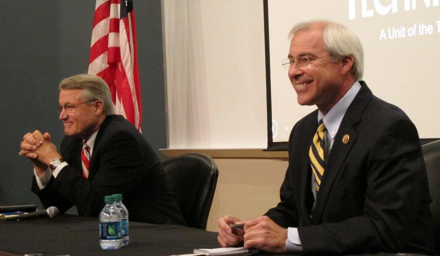 Republican Rick Allen, left, and Democratic U.S. Rep. John Barrow wait for their debate to begin Thursday, Oct. 16, 2014, at a college auditorium in Statesboro, Georgia. Barrow is a top target of the national Republican Party as he seeks a sixth term in Georgia's 12th District, a seat that was redrawn to favor a GOP candidate. (AP Photo/Russ Bynum)
