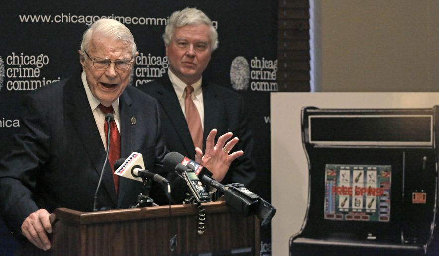 "Art Bilek, left, the executive vice president of the Chicago Crime Commission, accompanied by board member Jeffrey Johnson, speaks at a news conference, Thursday, Oct. 16, 2014, in Chicago. The anti-crime group is launching a campaign to eradicate what it says are video gambling devices at bars and other venues across Illinois, arguing the ""sweepstakes"" or ""coupon"" machines are illegal and sometimes overseen by organized crime. (AP Photo/M. Spencer Green)"