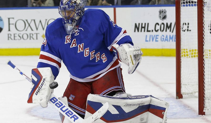New York Rangers goalie Henrik Lundqvist (30), of Sweden, stops a shot on the goal during the first period of an NHL hockey game against the Carolina Hurricanes on Thursday, Oct. 16, 2014, in New York. (AP Photo/Frank Franklin II)