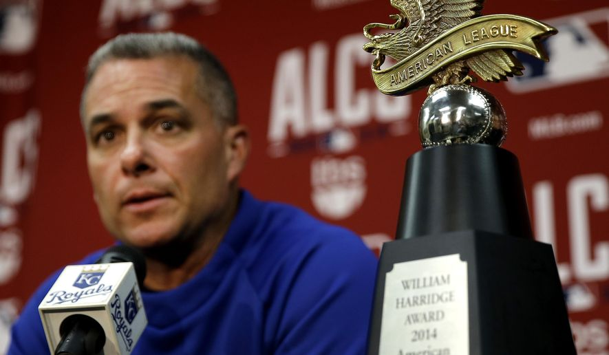 Kansas City Royals general manager Dayton Moore speaks to reporters during a news conference Thursday, Oct. 16, 2014, in Kansas City, Mo. The Royals won the American League championship Wednesday with a 2-1 win over the Baltimore Orioles and will host the National League winner in Game 1 of the World Series on Oct. 21. (AP Photo/Charlie Riedel)