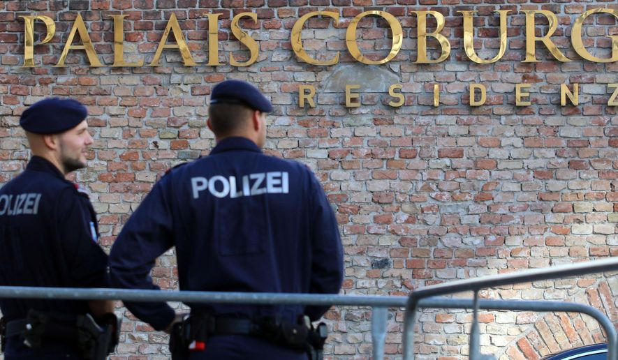 Police guard in front of Hotel Palais Coburg during closed-door nuclear talks in Vienna, Austria, Thursday, Oct. 16, 2014. EU foreign policy chief Catherine Ashton and Iranian Foreign Minister Mohammad Javad Zarif continue their nuclear talks in an effort to meet the target date of Nov. 24., but with less than six weeks left, there may be no alternative than to prolonging them. (AP Photo/Ronald Zak)