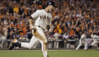 San Francisco Giants' Buster Posey celebrates an RBI single against the St. Louis Cardinals during the sixth inning of Game 4 of the National League baseball championship series Wednesday, Oct. 15, 2014, in San Francisco. (AP Photo/David J. Phillip)