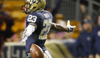 Pittsburgh wide receiver Tyler Boyd (23) celebrates as he goes into the end zone after he made a catch and took it in for a touchdown in the first quarter of an NCAA football game against Virginia Tech, Thursday, Oct. 16, 2014, in Pittsburgh. (AP Photo/Keith Srakocic)