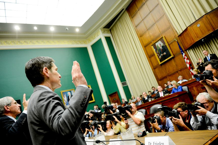Dr. Tom Frieden (right), director of the Centers for Disease Control and Prevention, testifies Oct. 16, 2014, on Capitol Hill in front of the House's Energy and Commerce Subcommittee on Oversight and Investigations on Ebola diagnosing mistakes and protecting health care workers in Dallas. (Andrew Harnik/The Washington Times)