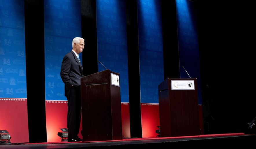 Democratic challenger Charlie Crist waits for Florida Gov. Rick Scott to start their second debate, Wednesday, Oct. 15, 2014 in Davie, Fla. Scott delayed the start of the debate because of an electric fan below Crist's podium. (AP Photo/Wilfredo Lee)