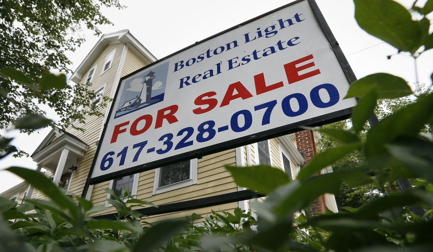 FILE - This July 10, 2014 file photo shows a home for sale in Quincy, Mass. Freddie Mac reports on average U.S. mortgage rates for the week on Thursday, Oct. 16, 2014. (AP Photo/Michael Dwyer, File)