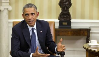 President Barack Obama speaks to the media about the government's Ebola response, in the Oval Office of the White House Thursday, Oct. 16, 2014, in Washington.  (AP Photo/Jacquelyn Martin)