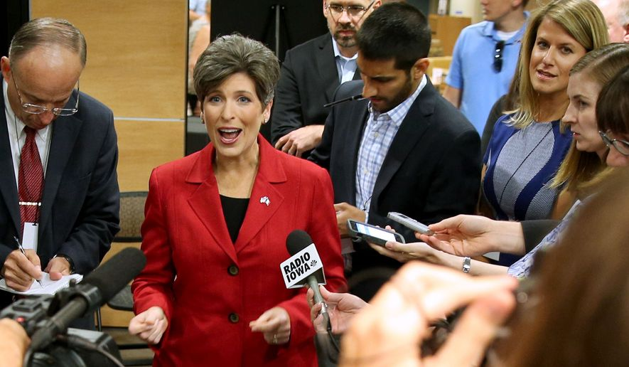 FILE - In  this Sept. 28, 2014 file photo Iowa Republican senate candidate Joni Ernst takes questions after debating her Democratic opponent U.S. Rep. Bruce Braley in Indianola, Iowa. As time runs short in the competitive Iowa Senate race, Democrats are trying to tarnish the centerpiece of Republican Ernst's successful Senate campaign _ her appealing image as a down-to-earth farm girl. (AP Photo/Justin Hayworth, File)