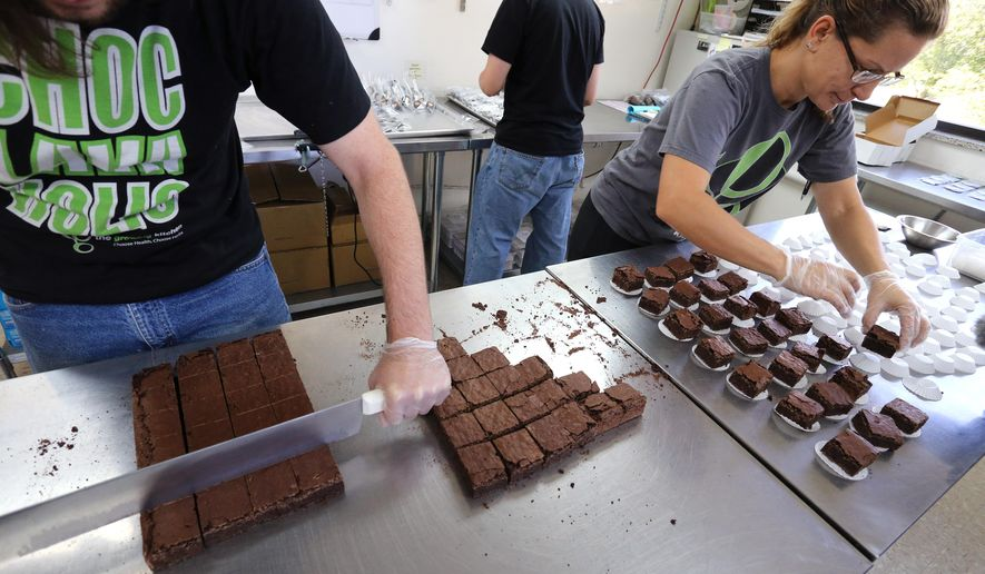 In this Sept. 26, 2014 photo, smaller-dose pot-infused brownies are divided and packaged at The Growing Kitchen, in Boulder. Recreational marijuana sellers are reaching out to novice cannabis users with edible products that impart a milder buzz and make it easy for inexperienced customers to find a dose they are less likely to regret taking. The marketing shift is the pot-industry equivalent of selling beer and wine alongside higher-alcohol options such as whiskey and vodka. (AP Photo/Brennan Linsley)