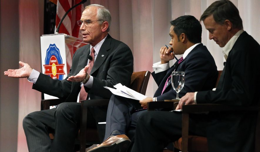 In this Oct. 6, 2014 photo, Republican candidate for governor Bob Beauprez gestures during a debate with Colorado Gov. John Hickenlooper, right, moderated by Politico reporter Manu Raju, center, in Denver. For Hickenlooper, a two-time Denver mayor, the upcoming election is his toughest yet. When he was elected governor four years ago, Republicans didn't mount a serious challenge. (AP Photo/Brennan Linsley)