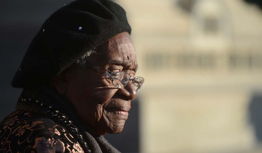 In this Saturday, Dec. 8, 2012 photo, Mattie Rice stands outside the Old County Courthouse, in Monroe, N.C., during a ceremony honoring 10 black men, nine of whom were slaves, who served in the Confederate Army. Rice, 91, the daughter of  Confederate soldier Weary Clyburn, died in September 2014. Rice had been devoted to confirming her father's Confederate service. (AP Photo/The Charlotte Observer, Todd Sumlin) MAGS OUT; TV OUT; NEWSPAPER INTERNET ONLY