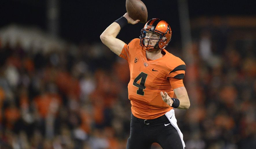 Oregon State quarterback Sean Mannion (4) passes against the University of Utah an NCAA college football game in Corvallis, Ore., Thursday, Oct.. 16, 2014. The University of Utah beat Oregon State 29-23 in overtime. (AP Photo/Troy Wayrynen)