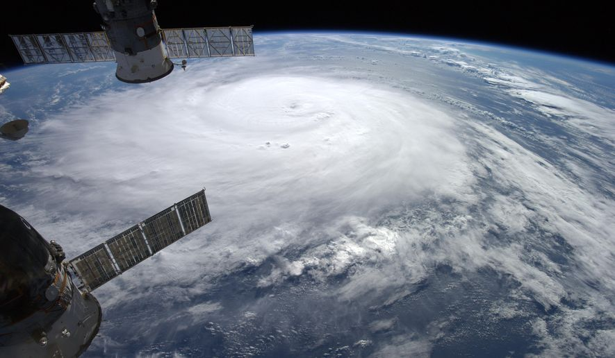 This image provided by NASA shows Hurricane Gonzalo taken from the International Space Station by European Space Agency astronaut Alexander Gerst as it moves toward Bermuda on Thursday, Oct. 16, 2014. Hurricane Gonzalo roared toward Bermuda as a powerful Category 3 storm on Friday. (AP Photo/Alexander Gerst/ESA/NASA)