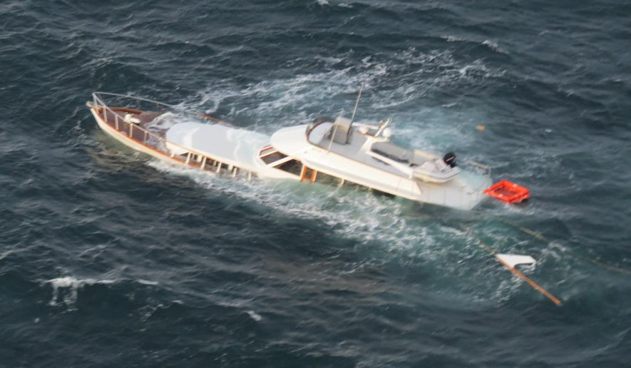 The Lady A, a 67-foot recreational vessel, sinks with about 700 gallons of diesel on board in 180 feet of water north of Dungeness Spit, Sequim, Wash., following the rescue of two people aboard by a small boat crew from Coast Guard Station Port Angeles, Friday, Oct. 17, 2014. The two people were taken to the station with no reported injuries. There is no report of a spill. (U.S. Coast Guard photo courtesy of Coast Guard Air Station Port Angeles)