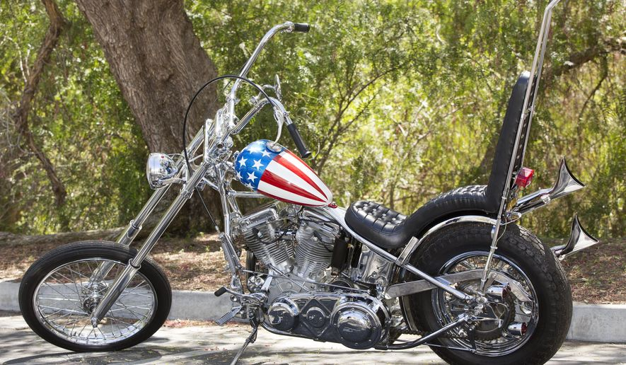 "FILE - In this Sept. 4, 2014 file photo, a vintage ""Easy Rider"" Captain America motorcycle is shown at Profiles in History auction house in Calabasas, Calif. Its principal authentication comes from ""Grizzly Adams"" actor Dan Haggerty, who had a bit part in ""Easy Rider"" and claims to have taken possession of the only bike that survived the filming of the druggy road movie. But Haggerty admitted this week, in an interview with Los Angeles Times, that he has authenticated and sold two Captain America bikes. (AP Photo/Damian Dovarganes, File)"