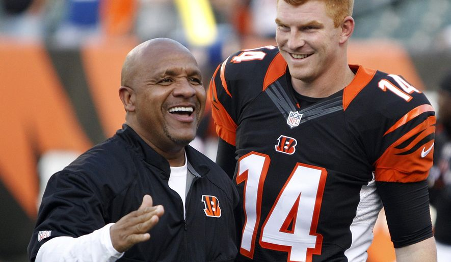 ADVANCE FOR WEEKEND EDITIONS, OCT. 18-19 - FILE - In this Aug. 28, 2014, file photo, Cincinnati Bengals offensive coordinator Hue Jackson stands with quarterback Andy Dalton (14) prior to an NFL preseason football game against the Indianapolis Colts in Cincinnati. Jackson has brought a different attitude to the Cincinnati Bengals defense in his first season as coordinator. He's also built a rapport with Dalton. (AP Photo/Frank Victores, File)