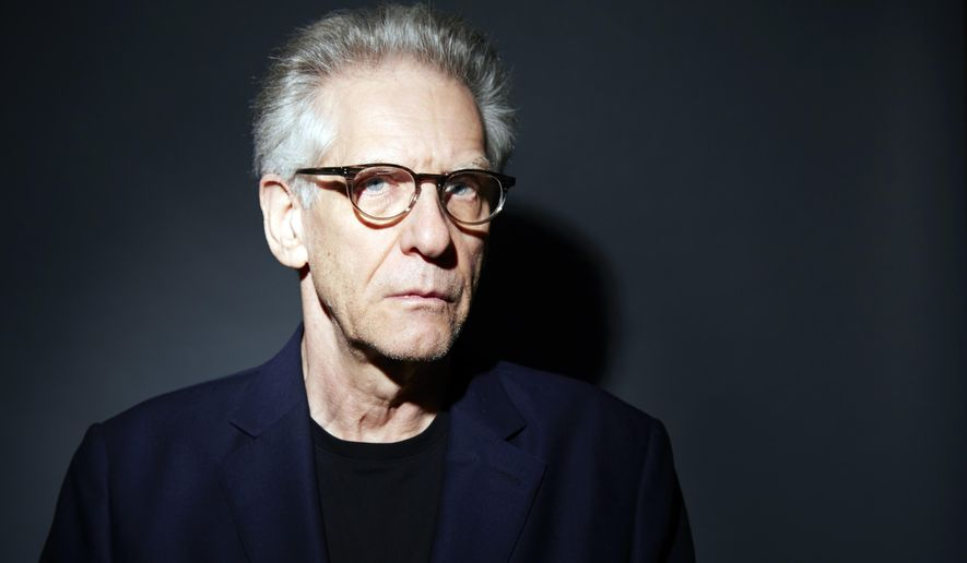 "In this Oct. 2, 2014 photo, filmmaker David Cronenberg poses for a portrait in promotion of his debut novel ""Consumed"" in New York. (Photo by Dan Hallman/Invision/AP)"