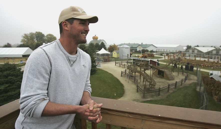 In this Oct. 13, 2014 photo, Jake Goebbert, a Hampshire, Ill., high school graduate and an outfielder with the San Diego Padres, looks over his family's pumpkin farm in Hampshire. Goebbert is back in Hampshire as operations manager on the farm in the off season. (AP Photo/Northwest Herald, H. Rick Bamman)  MANDATORY CREDIT