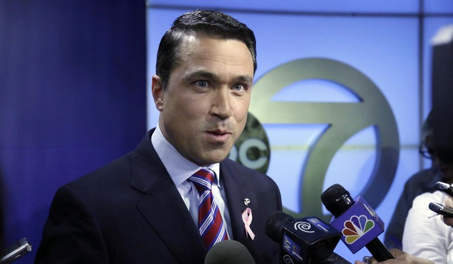 Incumbent Republican Rep. Michael Grimm answers reporters' questions after a recorded, televised debate for the 11th Congressional District race with his Democratic challenger Domenic Recchia, Friday, Oct. 17, 2014, at WABC-TV in New York. (AP Photo/Richard Drew)