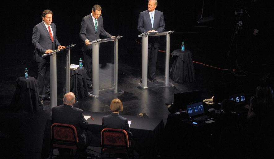 Connecticut Gubernatorial candidates, from left, Independent Joe Visconti, Gov. Dannel Malloy, and Republican Tom Foley actively discuss multiple topics during the gubernatorial debate at the Garde Arts Center in New London, Conn., Thursday Oct. 16, 2014. (AP Photo/The Day, Tim Cook)