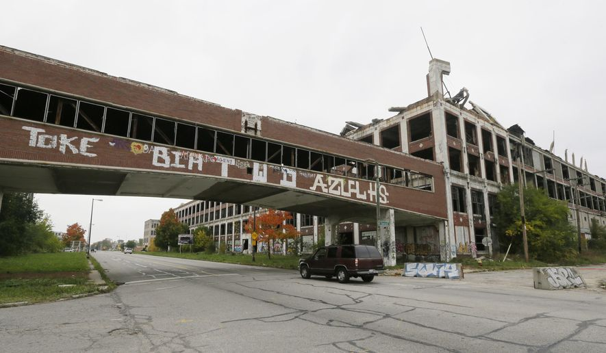 The Packard Plant is seen in Detroit, Friday, Oct. 17, 2014, more than 50 years after the last car was produced there. A developer from Peru bid $405,000 for the property during a tax foreclosure auction last year. Fernando Palazuelo hopes to breathe new life into the 40 blighted acres with homes, retail, offices, recreation and light industry. Crews started demolishing part of the plant on Friday. (AP Photo/Carlos Osorio)