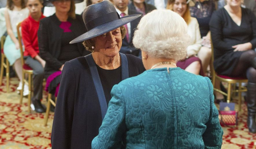 Dame Maggie Smith is made a member of the Order of the Companion of Honour by Queen Elizabeth II during an investiture ceremony at Windsor Castle, England, Friday Oct. 17, 2014. (AP Photo/PA, Dominic Lipinski) UNITED KINGDOM OUT  NO SALES  NO ARCHIVE