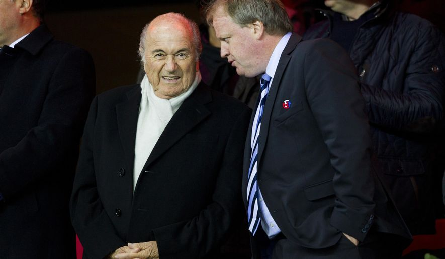 FIFA-president Sepp Blatter and the Norwegian football president, Yngve Hallen, at the UEFA Euro 2016 qualifying soccer match between Norway and Bulgaria at Ullevaal Stadium in Oslo, Monday Oct. 13, 2014. (AP Photo / Vegard Wivestad Groett, NTB scanpix) NORWAY OUT