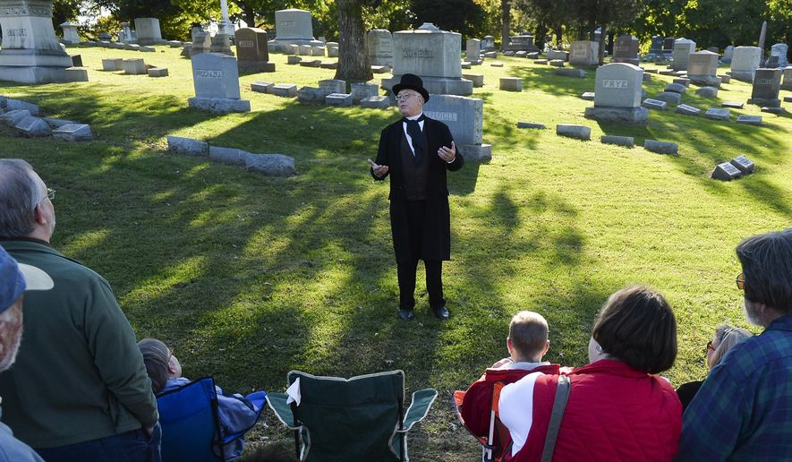 In this Oct. 11, 2014 photo, Prairie Folklore Theatre actors portray famous Peorians during the Historic Springdale Cemetery Tour in Peoria, Ill. The cemetery in central Illinois is embarking on a unique marketing campaign that includes a 5K race and actors dressing as people buried there, in an effort to encourage more people to buy lots. Ten events will be hosted this month in an effort to diversify the appeal of the sprawling East Bluff property. (AP Photo/Journal Star, Ron Johnson)