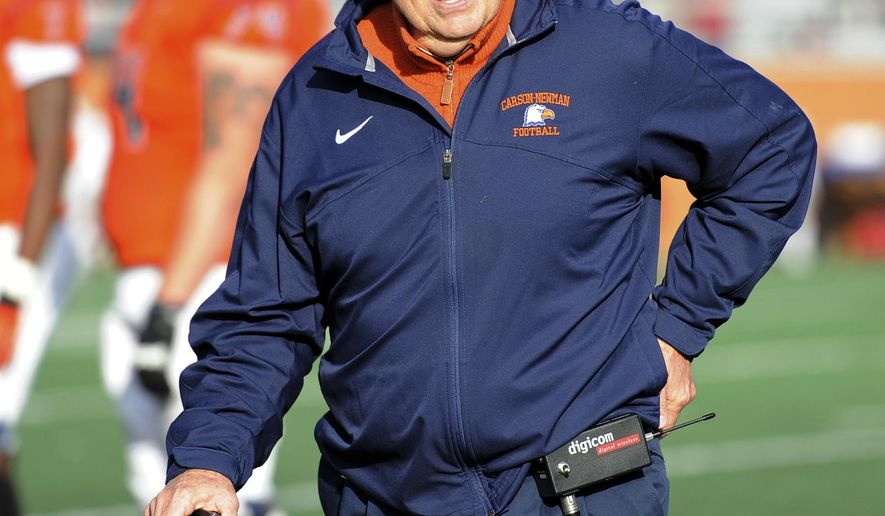 "ADVANCE FOR WEEKEND EDITIONS, OCT. 18-19 - In this Nov. 23, 2013, photo provided by Carson-Newman Uiversity, Carson Newman football coach Ken Sparks talks to his players during an NCAA Division II football game in Jefferson City, Tenn. Sparks has won five NAIA titles and has reached the NAIA or NCAA Division II championship game four other times during his 35-year coaching career. Sparks can reach one more milestone Saturday, Oct. 18, 2014,  as he seeks his 323rd career victory, which would tie him with Paul ""Bear"" Bryant for sixth place on the NCAA's all-time list. (AP Photo/Carson-Newman University, Adam Greene)"