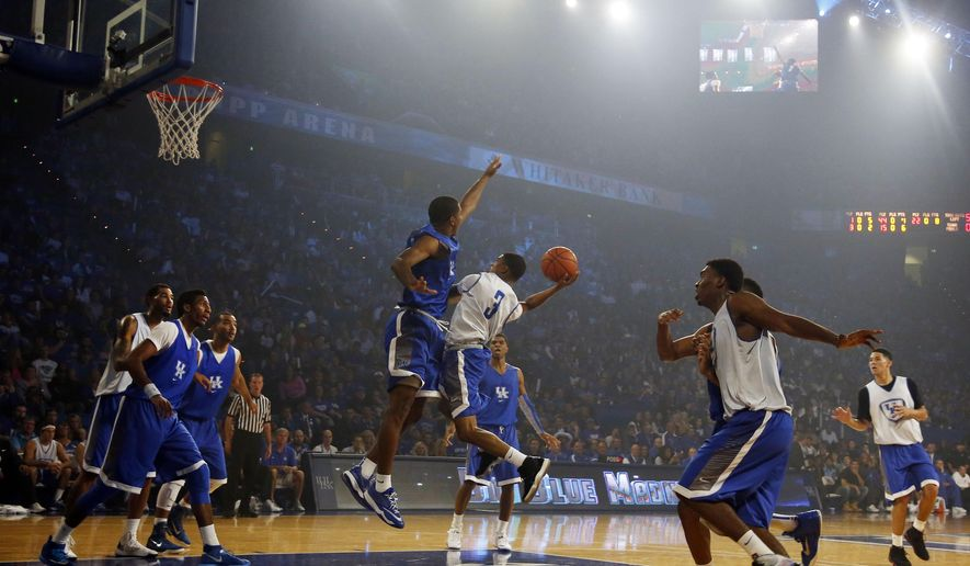 CORRECTS TO FRIDAY NOT THURSDAY - The Kentucky men's team scrimmages during their NCAA college basketball Big Blue Madness, Friday, Oct. 17, 2014, in Lexington, Ky. (AP Photo/James Crisp)