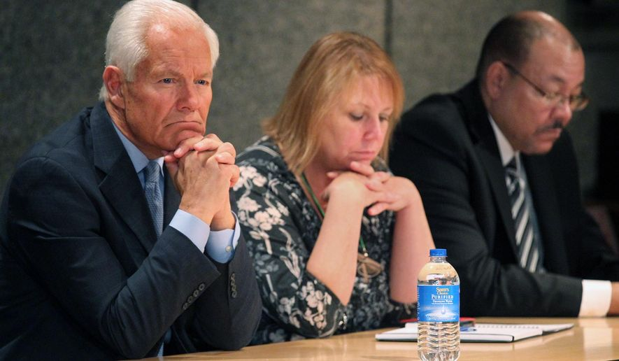Akron Mayor Don Plusquellic, left , Summit County  Emergency Management Agency Coordinator Valerie DeRose, and Superintendent of Schools David James wear looks of concern at news conference to update the media concerning Ebola at the Ocasek State Building on Thursday, Oct. 16, 2014 in Akron, OH. (AP Photo/Phil Masturzo, Akron Beacon Journal)