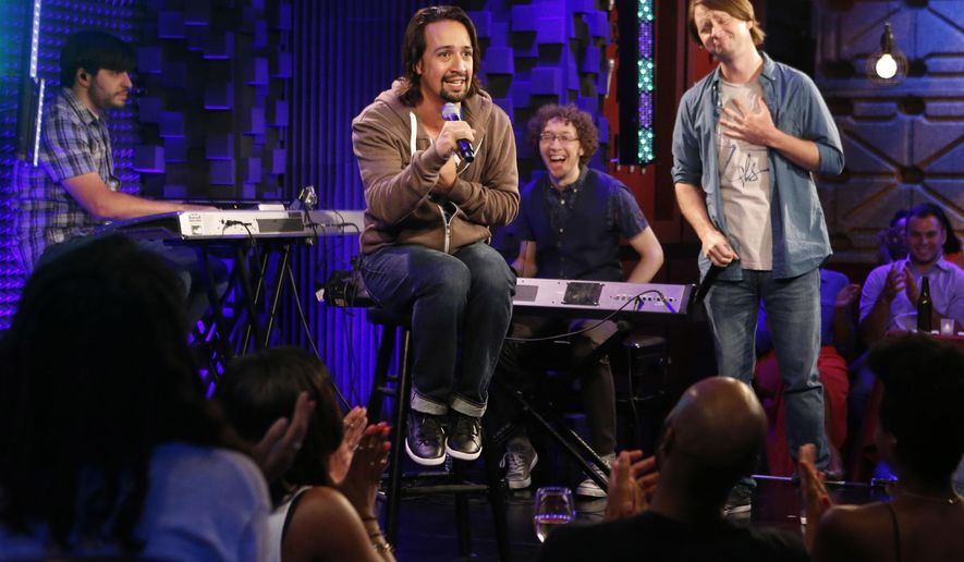 "In this Aug. 5, 2014 photo released by Pivot, Tony-winning composer and writer, Lin-Manuel Miranda, seated center, performs at Pivot's Freestyle Love Supreme in New York. The group has taped 10 episodes of ""Freestyle Love Supreme"" for Pivot, the cable network catering to millennials, otherwise known as the 18-34 demographic. The half-hour episodes mix footage from live shows with quirky scenes from the streets of New York. The series debuts Friday, Oct. 17 and episodes also will be available on iTunes. (AP Photo/Pivot, Jason DeCrow)"