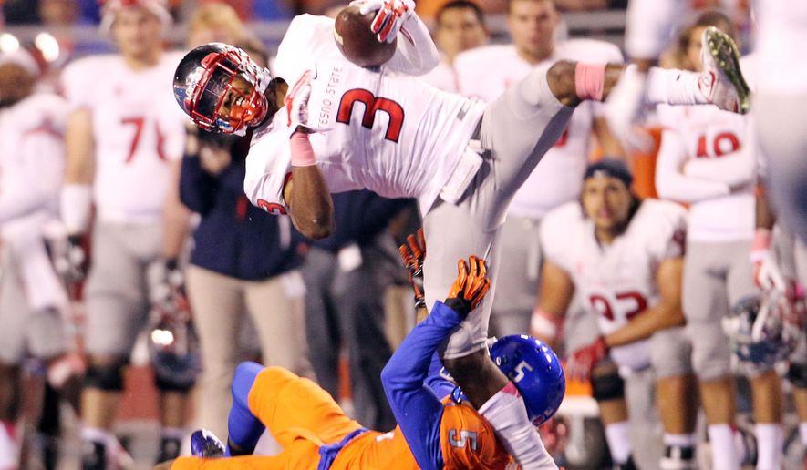 Fresno State wide receiver Josh Harper (3) makes a second-half reception against Boise State cornerback Donte Deayon (5) during an NCAA college football game Friday, Oct. 17, 2014, in Boise, Idaho. (AP Photo/The Idaho Statesman, Darin Oswald)