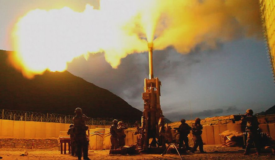 Soldiers with Battery C, 1st Battalion, 321st Airborne Field Artillery Regiment, 18th Fires Brigade, 82nd Airborne Division, fire 155 mm rounds using an M777 Howitzer weapons system, on Forward Operating Base Bostick, Afghanistan, 2009. (U.S. Army)