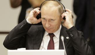 Russia Federation's President Vladimir Putin attends at the 10th Asia-Europe Meeting (ASEM) in Milan, Italy, Friday, Oct. 17, 2014. (AP Photo/Antonio Calanni)