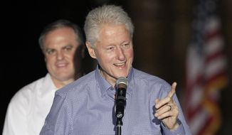 Former President Bill Clinton, right, speaks as fellow Democrat U.S. Sen. Mark Pryor listens at a political rally in Hot Springs, Ark., Friday, Oct.17, 2014. (AP Photo/Danny Johnston)