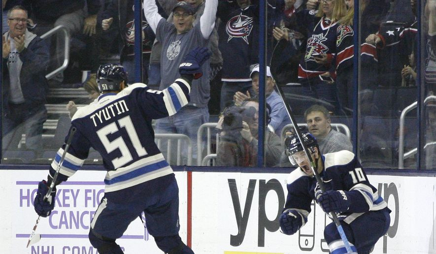 Columbus Blue Jackets' Jack Skille (10) celebrates his goal against the Calgary Flames, in front of teammate Fedor Tyutin, during the first period of an NHL hockey game, Friday, Oct. 17, 2014 in Columbus, Ohio. (AP Photo/ Mike Munden)