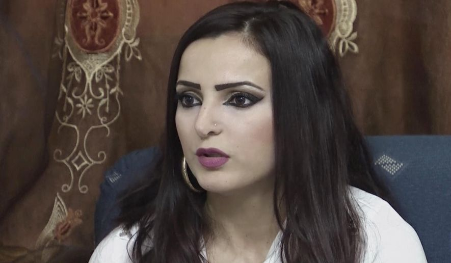 CAPTION CORRECTION, CORRECTS IDENTITY FROM MANAL MOUSA TO SABREN MOUSA - In this image made from AP video filmed on Wednesday, Oct. 8, 2014, Sabren Mousa, sister of Manal Mousa, speaks during an interview with The Associated Press at her family home in the Galilee village of Deir Al-Assad, northern Israel. Her sister Manal Mousa's goal is to win Arab Idol, the Arab world's premiere television song competition. The journey Manal Mousa and another singer Haitham Khalaily, 24, have taken from their villages in Israel to the competition in Lebanon could comprise a television drama of its own - featuring travel to an enemy country, Israeli security interrogations, and the complicated identity crisis of Israel's Arabs. (AP Photo/AP video)
