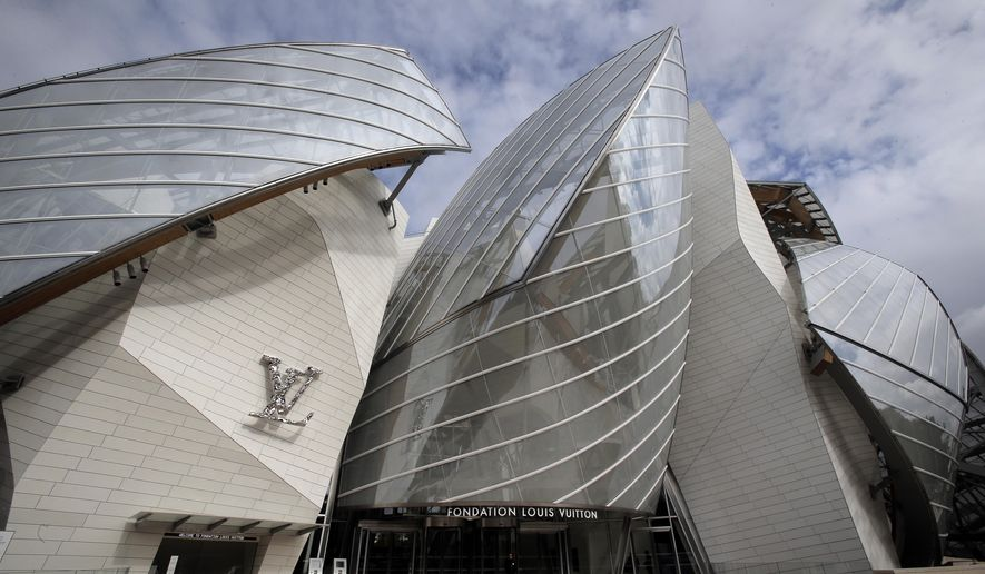 The Louis Vuitton Foundation art museum and cultural center, created by American architect Frank Gehry, is photographed during the press day, in Paris, Friday, Oct. 17, 2014. The 100-million-euro building, with billowing glass casing and 11 gallery spaces, has been compared to an iceberg or giant sailboat and took over a decade to make. (AP Photo/Christophe Ena)