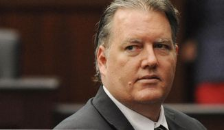 FILE - In this Sept. 27, 2014, file photo, Michael Dunn looks towards the legal representative sitting with his parents as his murder trial ends for the day in the Duval County Courthouse in Jacksonville, Fla. Dunn, convicted of first-degree murder in a retrial in September for fatally shooting 17-year-old Jordan Davis in November 2012 in an argument over loud music outside a Florida convenience store was sentenced Friday, Oct. 17, 2014,  to life in prison without parole. (AP Photo/The Florida Times-Union, Bob Mack, Pool, File