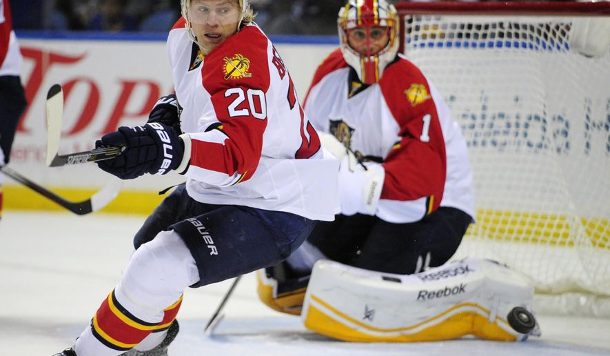 Florida Panthers left winger Sean Bergenheim (20), of Finland, reacts to an incoming shot along with goaltender Roberto Luongo (1) during the first period of an NHL hockey game against the  Buffalo Sabres, Friday, Oct., 17, 2014, in Buffalo, N.Y. (AP Photo/Gary Wiepert)