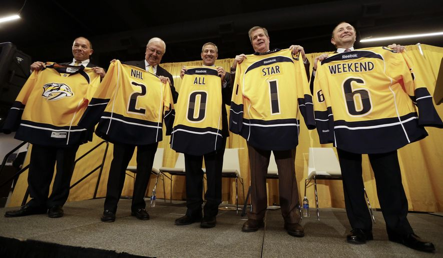 NHL Commissioner Gary Bettman, right, joins in the announcement Friday, Oct. 17, 2014, in Nashville, Tenn., that the 2016 NHL hockey All-Star game will be held in Nashville. From left are Nashville Predators CEO Jeff Cogen, Predators Governor Tom Cigarrin, Bridgestone Americas CEO Gary Garfield, Nashville Mayor Karl Dean, and Bettman. (AP Photo/Mark Humphrey)