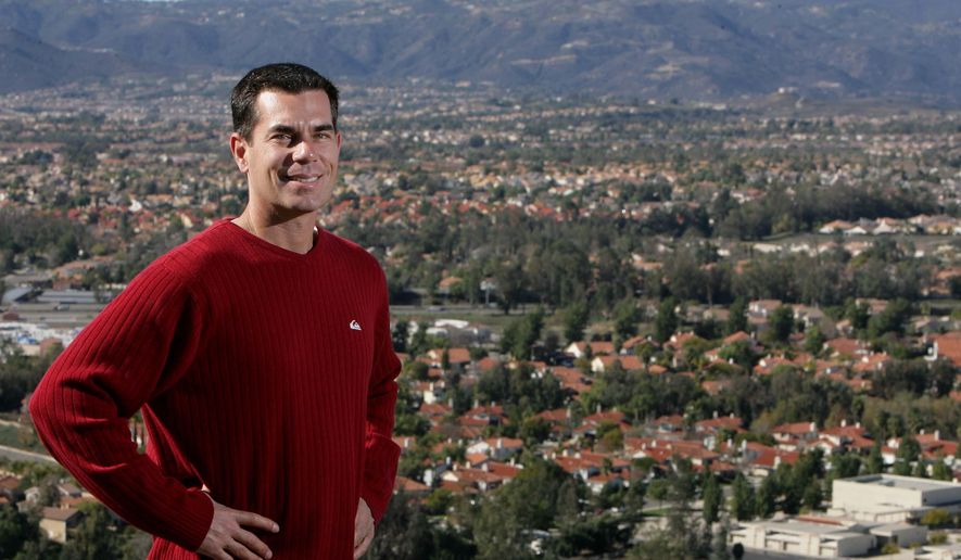 In this Dec. 2010 photo, Alan Long, mayor of  Murrieta stands overlooking Murrieta, Calif.  Long was driving under the influence when he rear-ended a car and injured four cheerleaders, police said. Long, who was arrested on suspicion of DUI, was released Friday, Oct. 17, 2014, on $50,000 bail, according to The Riverside Press-Enterprise. (AP Photo/The Press-Enterprise, Frank Bellino)
